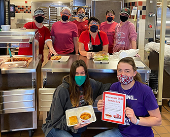 Food Service workers displaying a healthy lunch